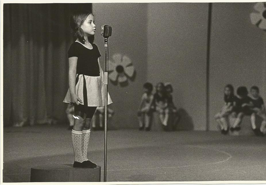 12. Milica is performing as a little girl
