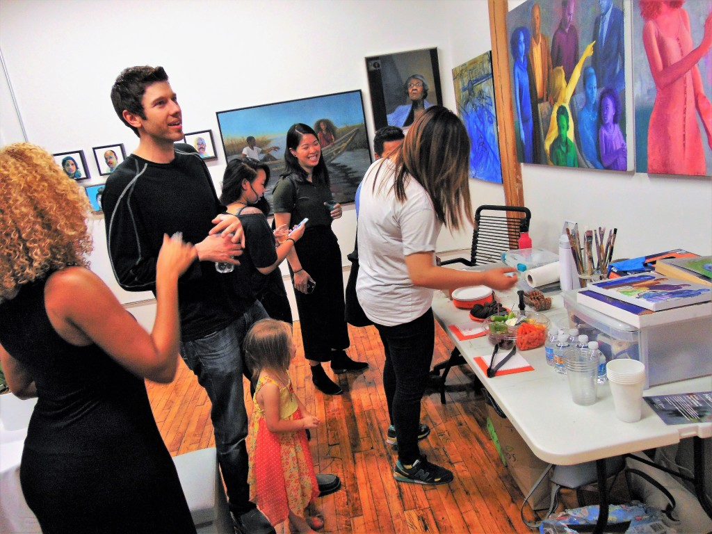 12a. 12. Ashley Jan Gardner (right) in her studio and her guests