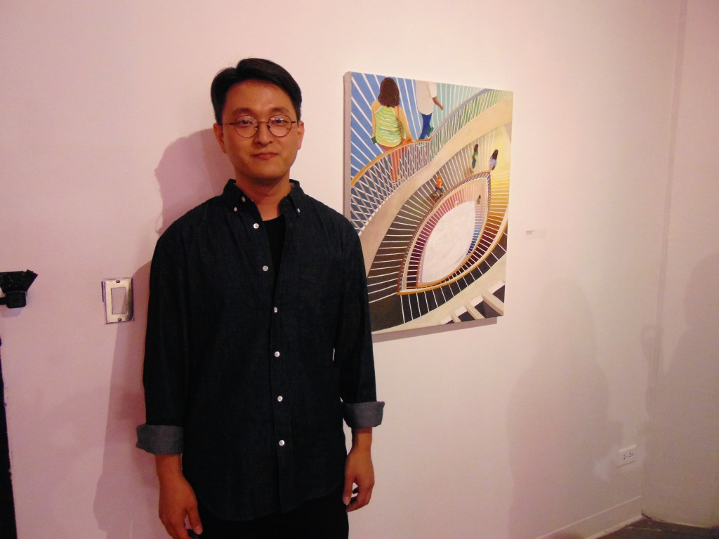 2. Artist Yongmin Cho beside his artwork