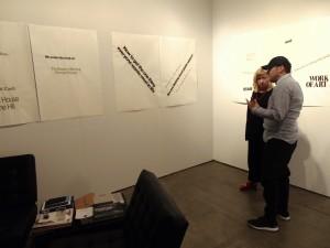 2. Gallerist Rene Schmitt is explaining the work of American artist Lorraine O'Grady